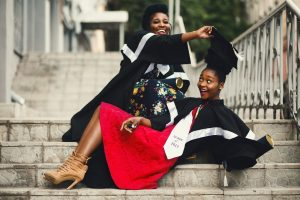 shallow-focus-photography-of-two-women-in-academic-dress-on-901964